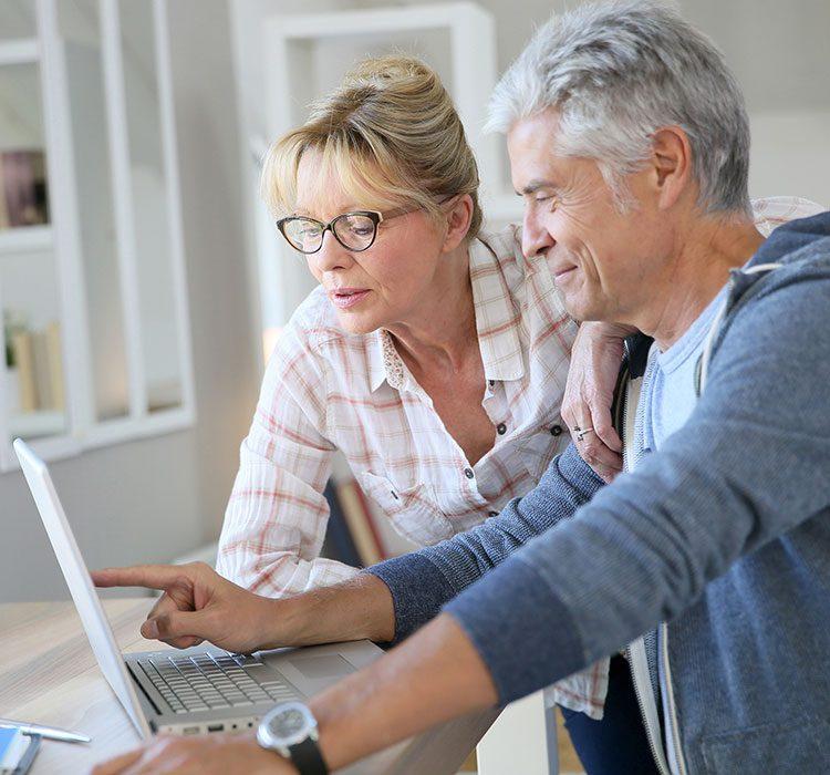 bigstock-Senior-couple-at-home-checking-102394388
