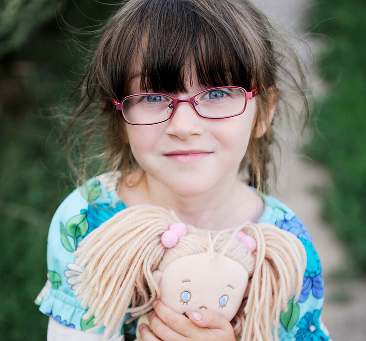 a young girl with glasses
